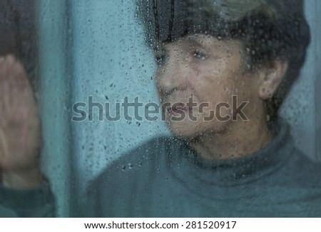 Elderly, sad and lonely women suffering from depression - stock photo