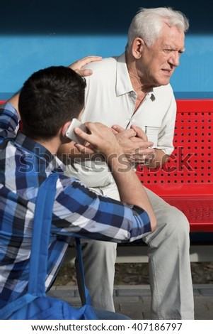 Elderly sick man is having chest pain - stock photo