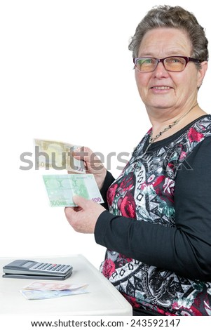 Elderly woman counting and showing money with calculator isolated on white background - stock photo