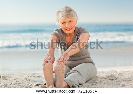 Elderly woman doing her streches - stock photo
