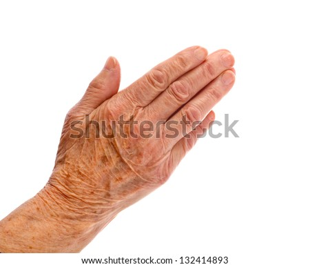Elderly woman hand on an isolated background - stock photo