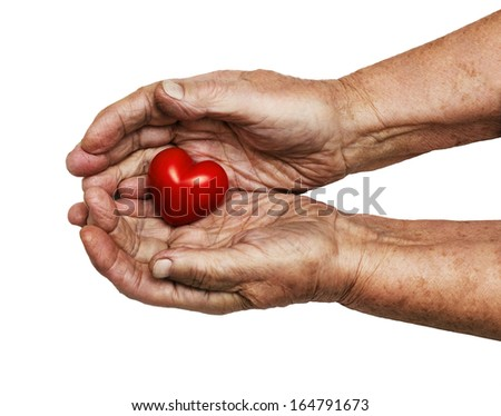 elderly woman keeping red heart in her palms, symbol of care and love, isolated on white background - stock photo