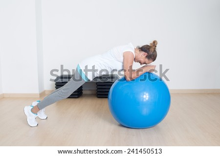Elderly woman making exercise on fitness ball - stock photo