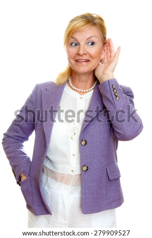 Elderly woman old senior 60-65 years woman with hardness of hearing listening, white teeth, in suit with big blue eyes, isolated on white background, Positive human emotion, facial expression - stock photo