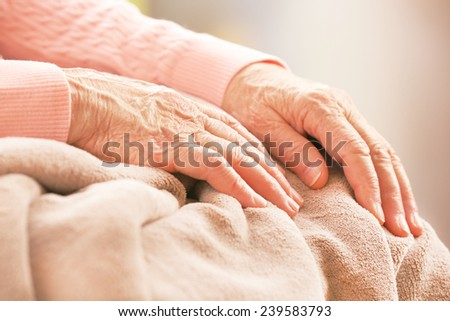 Elderly woman's hands, care for the elderly concept - stock photo