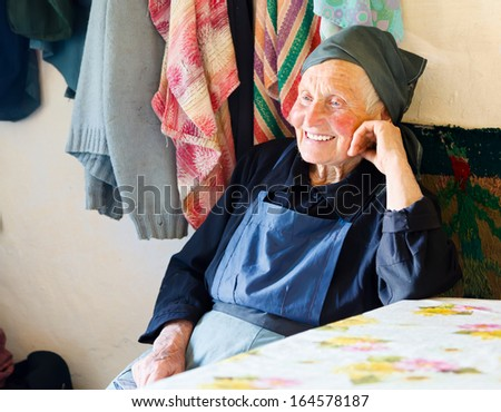 Elderly woman smiling kindly while telling a story. - stock photo
