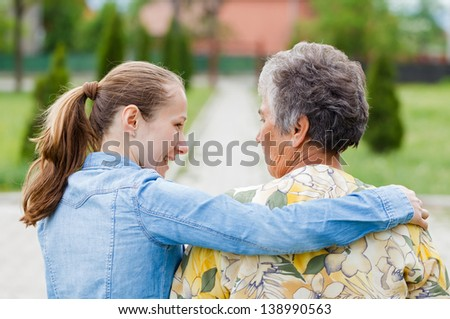 Elderly woman tell her complaints to the carer - stock photo
