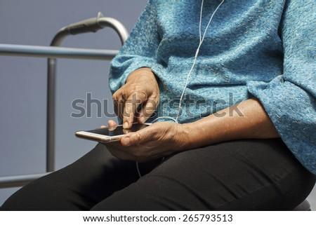 Elderly woman using mobile phone. - stock photo