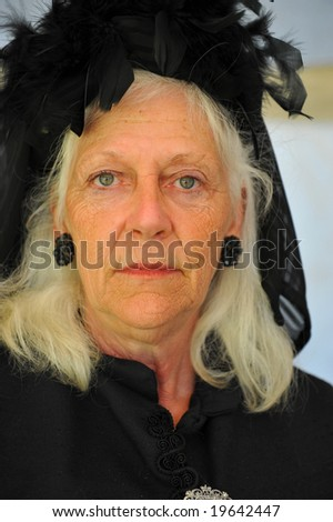 Elderly woman wearing black clothing to indicate mourning. Clothing typical of late 17th century - stock photo