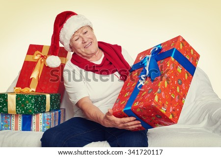 elderly woman with christmas box gift - happy holiday concept - stock photo