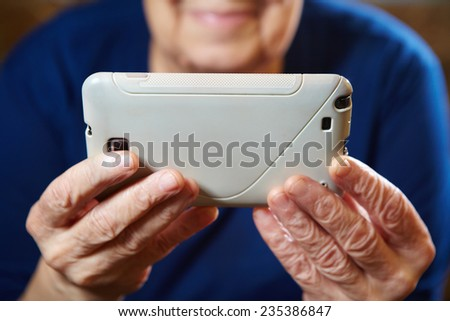 Elderly woman with tablet computer. Senior people using internet - stock photo