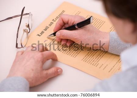 elderly woman writing testament - stock photo