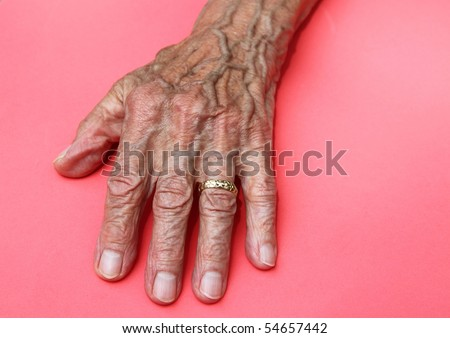 elderly womans wrinkled old hand - stock photo