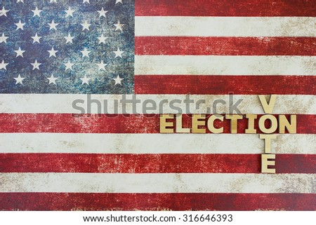ELECTION and VOTE text on vintage rustic American flag canvas background - stock photo