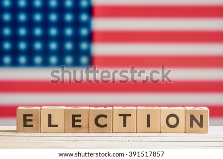 Election sign on a table with the american flag - stock photo