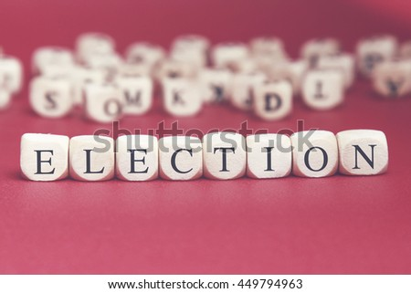 Election word written on wood cube with red background - stock photo