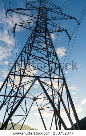 Electrcial transmission tower with blue sky - stock photo