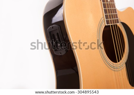 Electric acoustic yellow guitar close up isolated on white background - stock photo