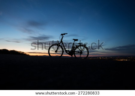electric bicycle in sunset  - stock photo