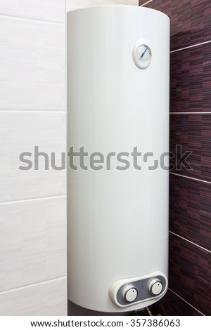 Electric Boiler (wall water heater) in bathroom - stock photo