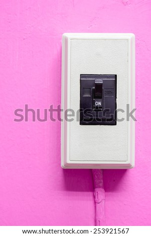 electric breaker on pink wall - stock photo