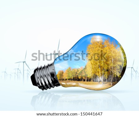 Electric bulb and windmill generators. Renewable energy concept - stock photo