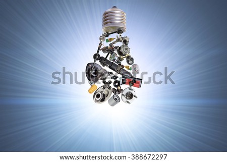 Electric bulb with spare parts for car. Spare parts and auto parts for car - stock photo