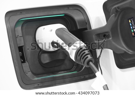 Electric car charging detail. Green and renewable energy technology. Horizontal - stock photo