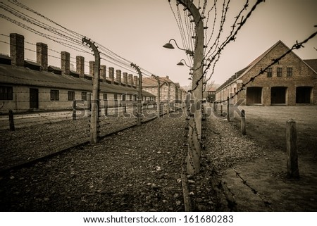 Electric fence in former Nazi concentration camp Auschwitz I, Poland - stock photo
