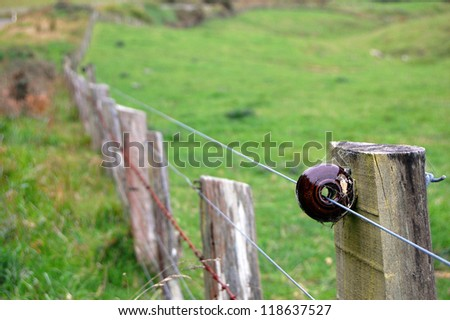 Electric fence on farm - stock photo