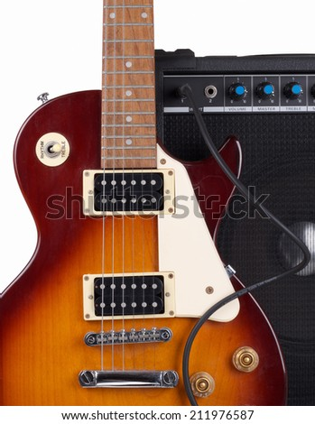 Electric Guitar and Amplifier on White Background - stock photo