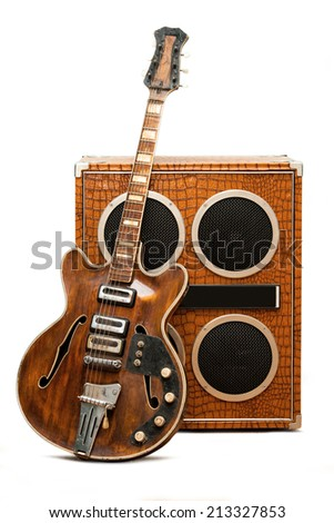 Electric guitar and column speaker - stock photo