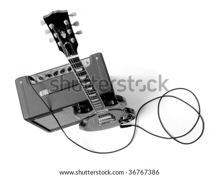 Electric guitar and combo. Shot in studio. - stock photo