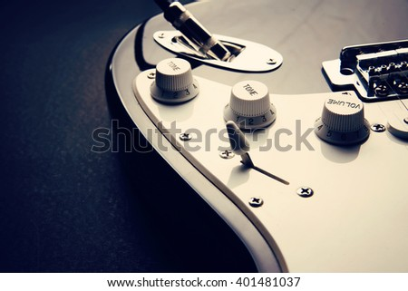 Electric guitar. Detail, selective focus. Shallow depth of field. Music, learning how to play the guitar and abstract concept - stock photo
