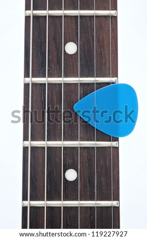 electric guitar fingerboard with dot inlay and a pick - stock photo
