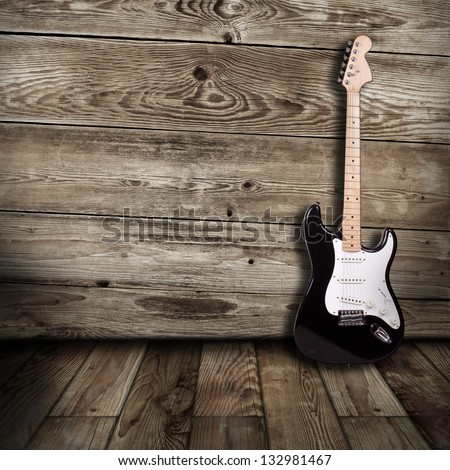 electric guitar in the wooden room - stock photo