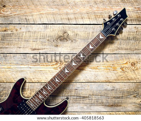 Electric guitar on wooden background vintage look - stock photo