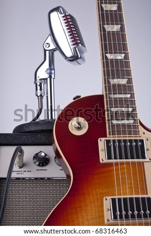 Electric guitar with amp and vintage microphone - stock photo
