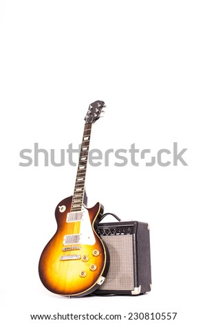 electric guitar with amplifier - stock photo