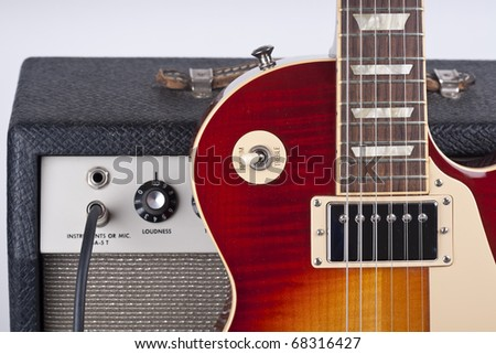 Electric guitar with old amplifier and guitar cable - stock photo