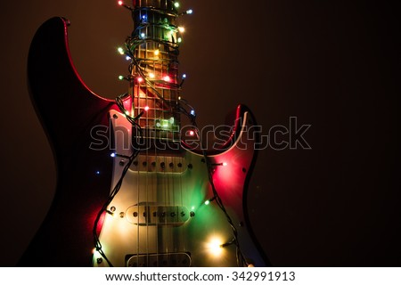 electric guitar wrapped by garland - stock photo