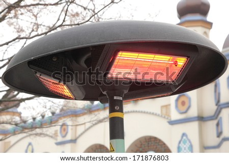 Electric heater pole with halogen coils , Korea - stock photo