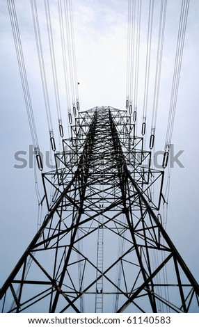 Electric high voltage post with the sky background - stock photo