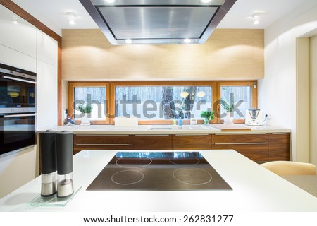 Electric hob on a white wheat in modern kitchen - stock photo