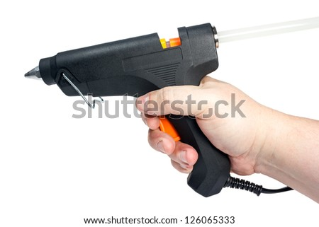 Electric hot glue gun in hand isolated on a white background. - stock photo