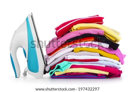Electric iron and pile of colorful clothes, isolated on white - stock photo