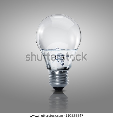 Electric light bulb with clean water inside it - stock photo