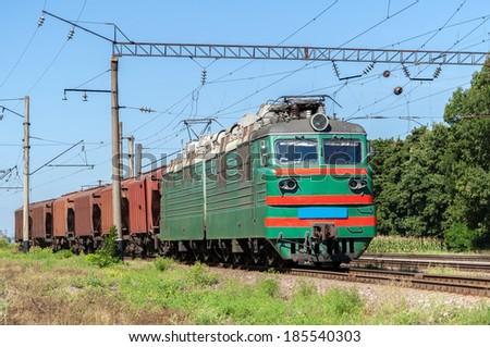 Electric locomotive hauling a grain train - stock photo