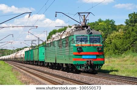 Electric locomotive pushing a cargo train in Ukraine - stock photo