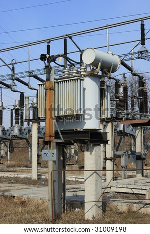 Electric main and small high-voltage transformer - stock photo